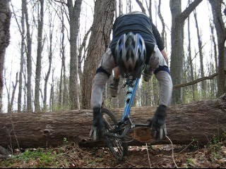 Falling_log_jump_mountain_biking
