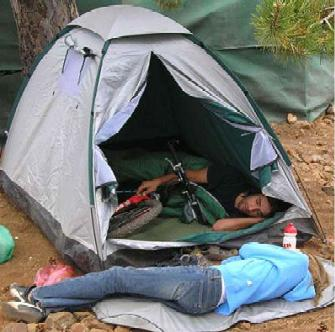 Sleeping_with_bike_in_tent_while_gi
